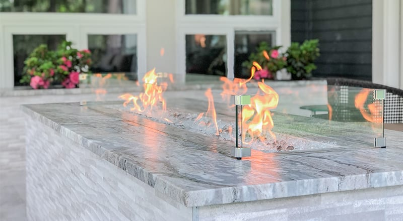 outdoor fireplace on outdoor patio